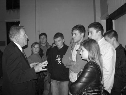A number of medical students chatting with Dr. Cameron after his presentation at the Medical University. The large conference room was packed (around 3-400 attended), and these students stayed afterward for about 15 minutes to discuss various aspects of homosexuality.